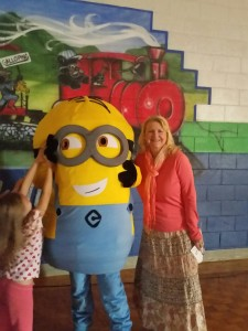 Mrs. Rossa poses with one of the minions.