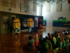 Minions from Clyde Fire Department educate students about Halloween safety.